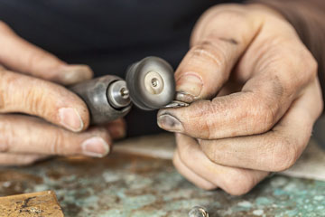 polishing silver with a buffing wheel